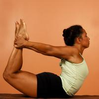 hatha yoga pose spinal bend holding legs